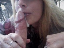 Hot mature wife blowing cock outdoor