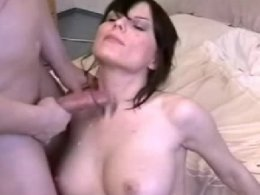 Brunette gagging on a dick