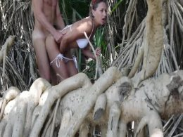 Sexy lady fingers herself and blows dick in jungle and on the beach.