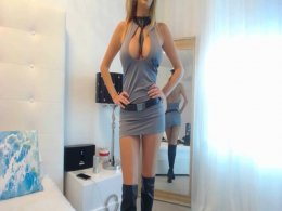 Big breasted chick in boots teasing in her skimpy dress