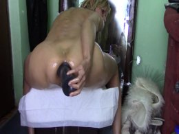 Sexy milf stuffs her asshole with a big dildo and cums