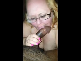 Fat blonde chick enjoys a black boner between her lips