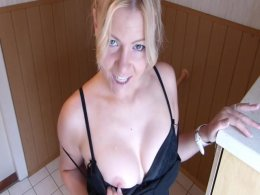 Beautiful blonde milf impales herself on a big wall mounted dildo