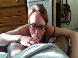 Redhead with glasses sucks a dick and swallows cum