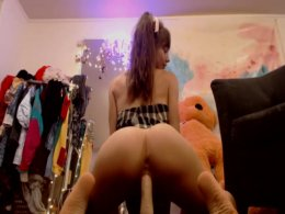 Skinny girl rides a huge dildo and cums really hard