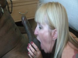 Fit blonde lady takes her time while sucking a black cock