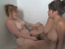 Busty lesbians makes webcam sex fun and share a dildo