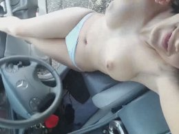 Young babe undressing and taking selfies in a parking lot