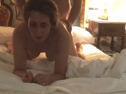 Mature couple cheating on their spouses in a hotel room