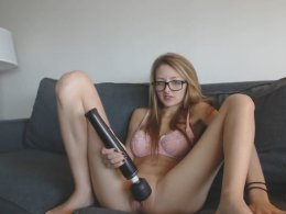 Hot and nerdy redhead makes a homemade masturbating video