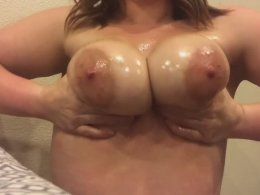Wife making her big meaty tits oiled up and shiny